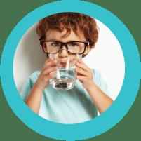 child tasting clean water